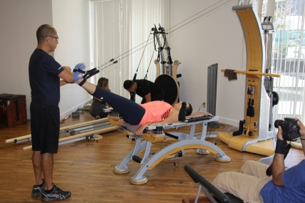 Louis Training a client on the GYROTONIC® Pulley Tower Combination Unit, Therapy and Training in Beverly Hills, CA - Beverly Hills Posture offers Chiropractic Care, yoga, Acupunture, and Massage Therapy, Walker Ozar - Doctor of Chiropractic, Chiropractor in Beverly HIlls California